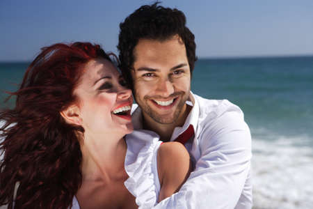 young couple enjoying on the beach happiness