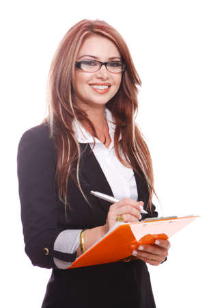 Businesswoman holding a clipboard and writing notes.