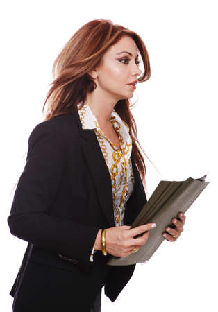 Side view of businesswoman late for work with files in her hand.  Stock Photo - 7511260