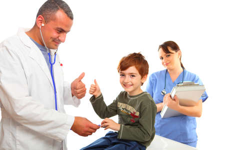 Male Doctor and a nurse examining a boy, isolated on white photo
