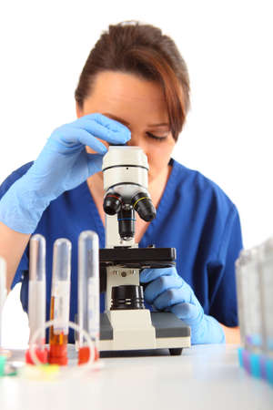 Female Researcher looking into a microscope photo