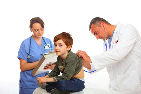 Isolated on white, Doctor and nurse examining a boy photo