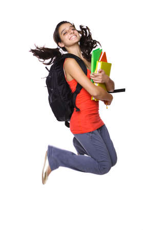 teenage girl jumping with books in her hand isolated on white photo