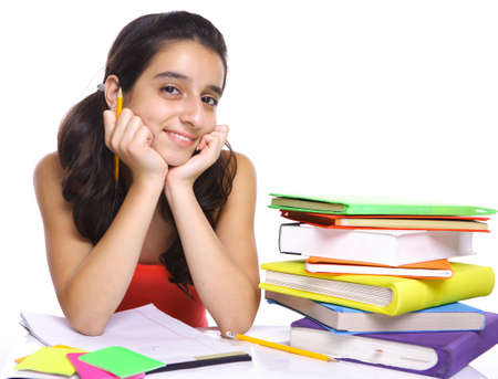 teenager girl posing for the camera near her books isolated on white