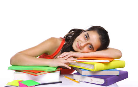 getting late: young girl leaning on her school books isolated on white Stock Photo