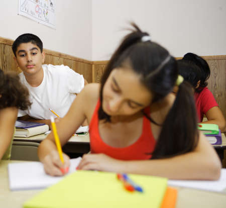 Close up of boy cheating off of a girl student Stock Photo