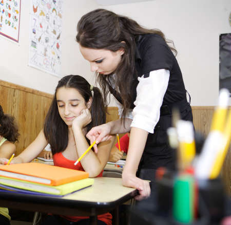 Teacher helping out a student in need