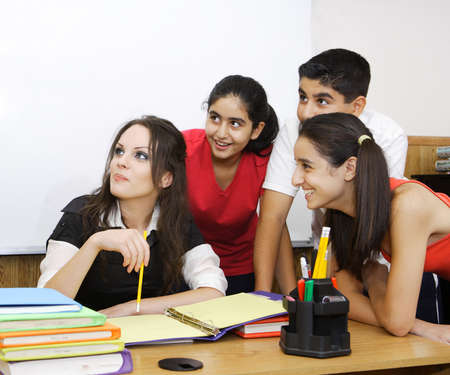 teacher and students looking at something