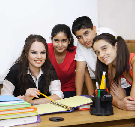 Back to school, teacher and students posing. Stock Photo