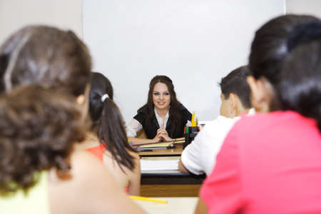 students in the classroom listening to the teacher Stock Photo