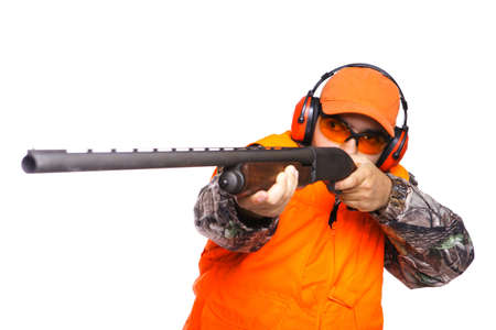 Hunter aiming a shotgun at prey, while wearing camouflage clothing, isolated on white