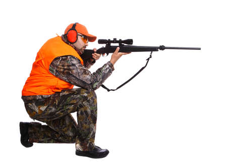 Hunter kneeling and aiming at prey, isolated on white