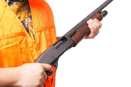 Hunter holding a shotgun, isolated on white photo