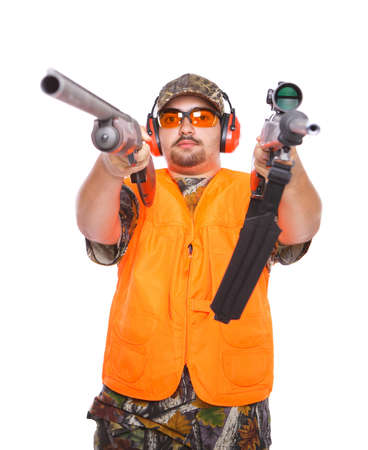Hunter pointing a rifle and a shotgun at the camera, isolated on white Stock Photo - 7853091