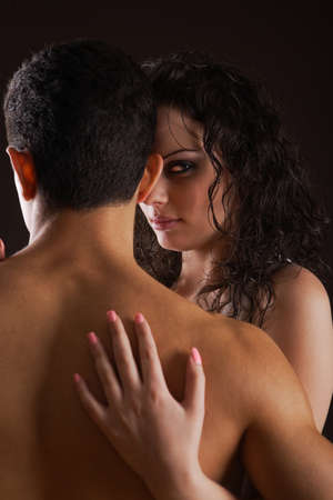 woman hugging man isolated on black background Stock Photo - 7983338