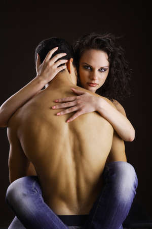 Seducing each other while isolated on black background Stock Photo - 7983328