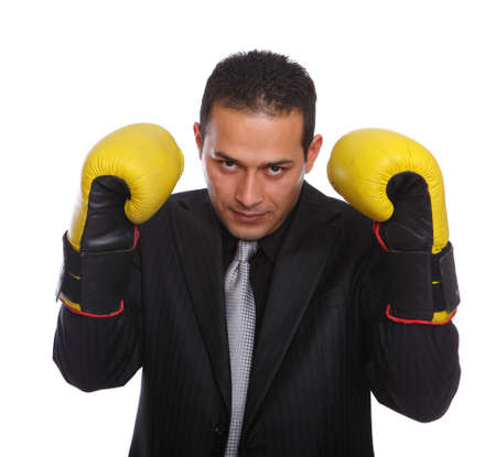 Tough Businessmen wearing boxing gloves isolated on white photo
