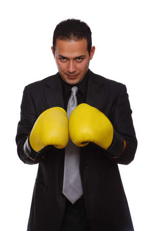 Businessman wearing boxing gloves isolated on white photo