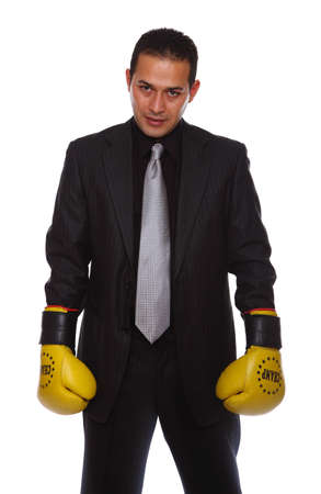 Tough businessman staning in attack stance waiting for the competition photo
