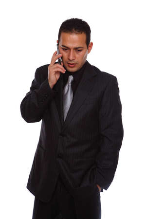Mobile Phone and Businessman isolated on white photo