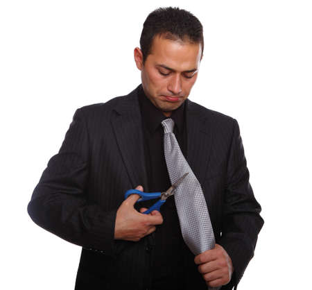Fired Businessman cutting his necktie, isolated on white