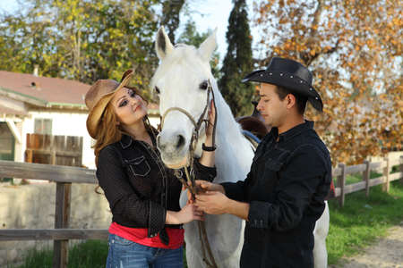 black cowgirl: Couple petting their beautiful white horse
