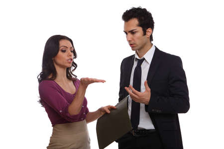 Two office workers stand and discuss matters of importance. Stock Photo - 19641955