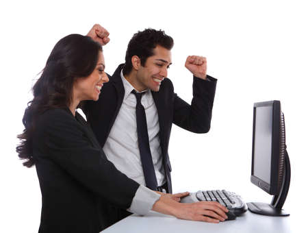 Excited Business couple looking at the desktop computer Stock Photo - 19639820