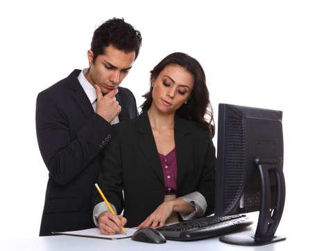 problemsolving: Businesscouple problemsolving near a desktop computer