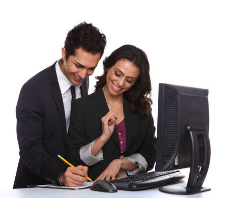 Business couple working with computer isolated on white photo