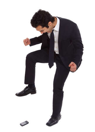 Businessman is crushing his phone with foot. Stock Photo