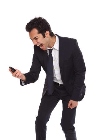angry businessman: Angry businessman yelling at his phone from dispair
