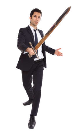 A businessman with a long sword in attacking stance Stock Photo - 19641948