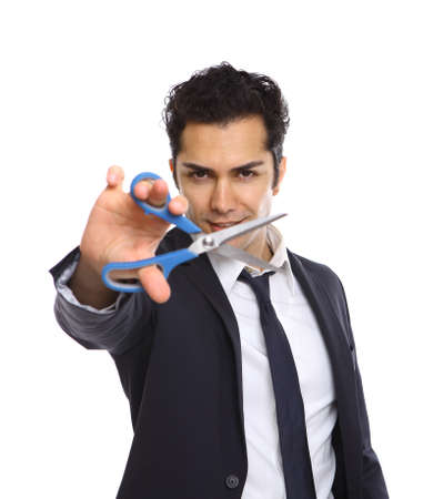 Businessman showing scissors in his right hand photo