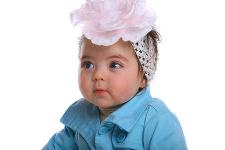 6 12 months: small child baby isolted on white wearing a hair bow Stock Photo