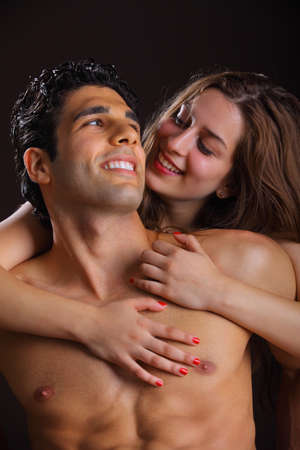 Young couple holding each other lovingly naked photo