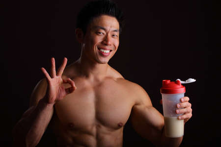 Perfect finger gesture for Protein Drink holding a jar Stock Photo - 16940369