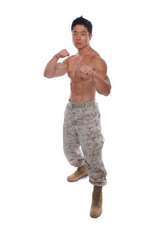 asian abs: Attacking stance Muscular Marine in Uniform isolated on white