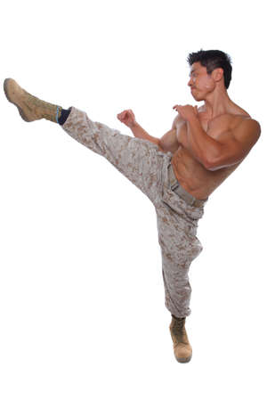 Muscular Marine high kick in Uniform isolated on white photo