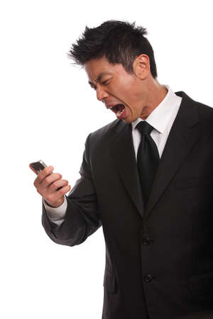 Annoyed Asian Man yelling at his phone isolated on white photo