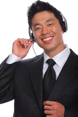 アジア人通関サービス担当者は電話で話して 写真素材