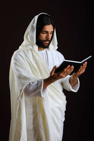 Jesus Christ of Nazareth reading a prayer photo