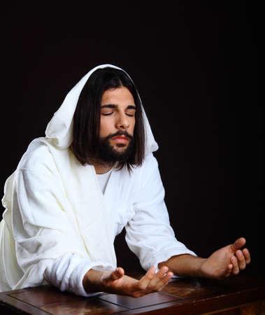Jesus Christ of Nazareth open hands prayer photo