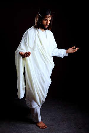 Jezus Christus van Nazareth herboren geïsoleerd op zwart Stockfoto