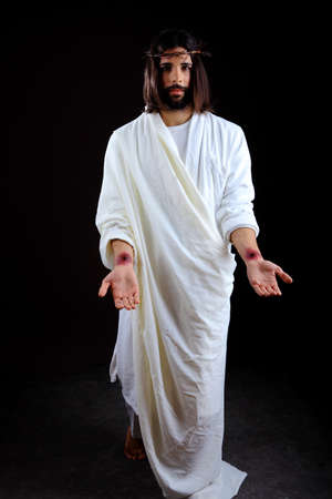 jesus blood: The Resurrected Christ reaching out with scars on his hand Stock Photo