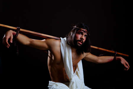 Jesus Crucifixion with a cross on his back photo