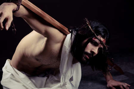 Struggling Jesus Christ for Easter with the cross on his back photo