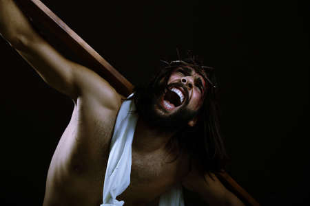 Jesus kneeling while his mouth is open screaming photo