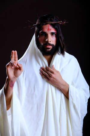 Jesus Gesturing while wearing a white robe