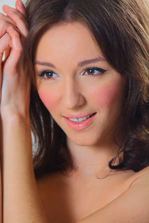 no teeth smile: White toned beautiful face young woman causcasian